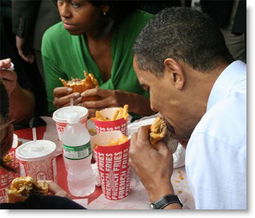 Michelle Obama eating cheeseburger